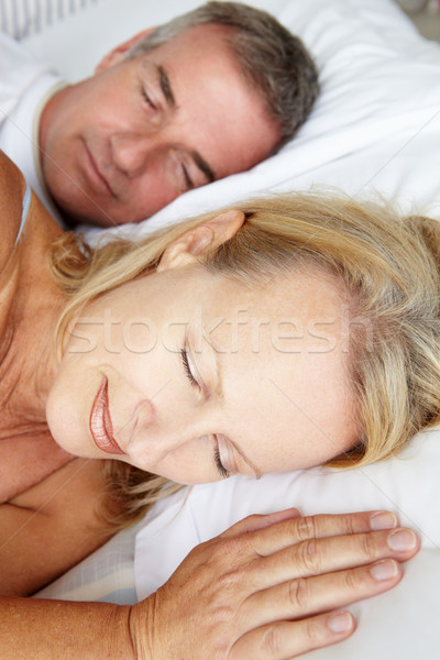 Stock photo: Head and shoulders mid age couple sleeping