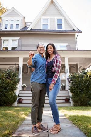 Hispanic couple outside new home Stock photo © monkey_business
