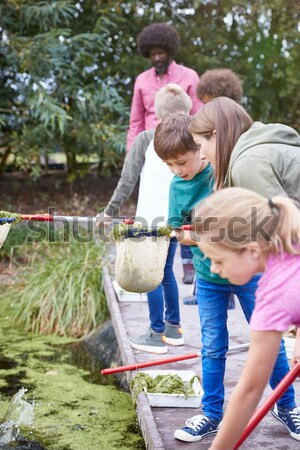 Woman and child with picnic on allotment Stock photo © monkey_business