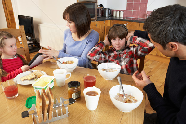 Parents Taking Away Gadgets From Children Whilst Eating Breakfas Stock photo © monkey_business