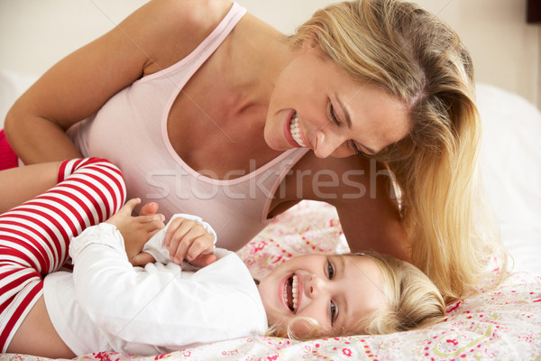 Mother And Daughter Relaxing Together In Bed Stock photo © monkey_business