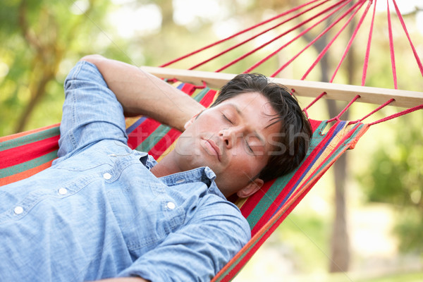 Stock photo: Man Relaxing In Hammock