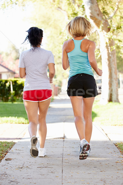 Rear View Of Two Female Runners On Suburban Street Stock photo © monkey_business