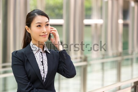 Businesswoman Commuting To Work On Train Using Mobile Phone Stock photo © monkey_business