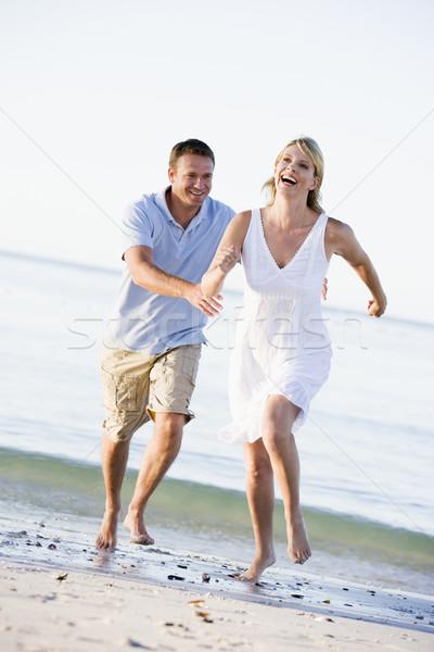 Сток-фото: пару · пляж · играет · улыбаясь · женщину · человека