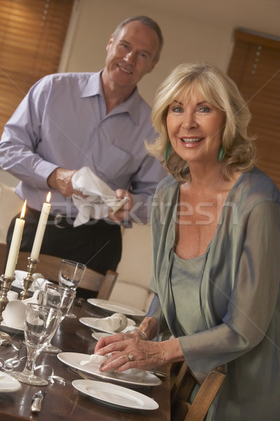 Couple Preparing Table For A Dinner Party Stock photo © monkey_business