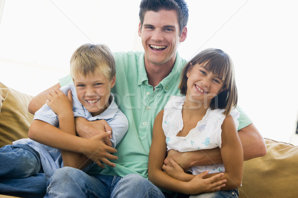 Сток-фото: человека · два · молодые · детей · гостиной · улыбаясь