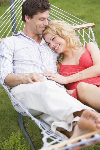 Couple relaxing in hammock smiling Stock photo © monkey_business
