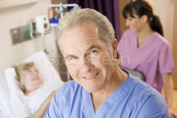 Médecin permanent up patient femme homme Photo stock © monkey_business
