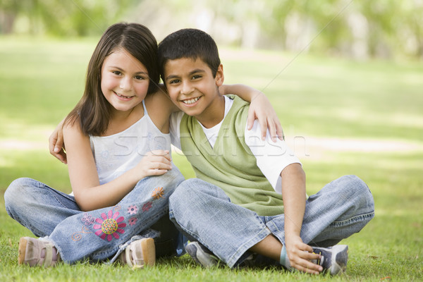 Two children sitting in park Stock photo © monkey_business