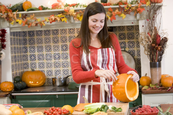 Woman carving jack o lantern on Halloween and smiling Stock photo © monkey_business