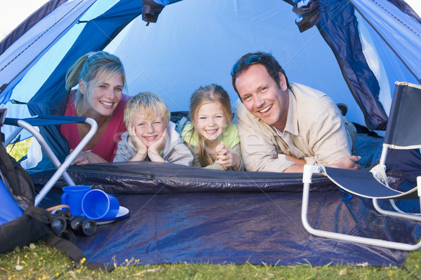 Family camping in tent smiling Stock photo © monkey_business