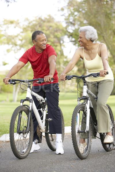 Stockfoto: Paardrijden · fietsen · park · man · gelukkig