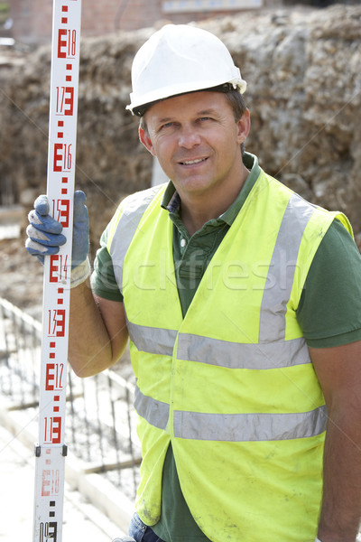 Construction Worker Holding Measure Stock photo © monkey_business