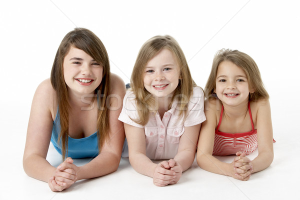 Three Girls Piled Up In Pyramid In Studio Stock photo © monkey_business