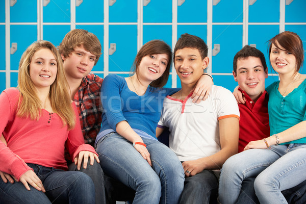 Teenage Students Relaxing By Lockers In School Stock photo © monkey_business
