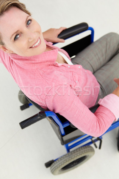 Mid age woman in wheelchair Stock photo © monkey_business