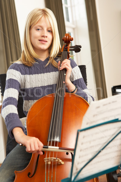 Girl playing cello at home Stock photo © monkey_business