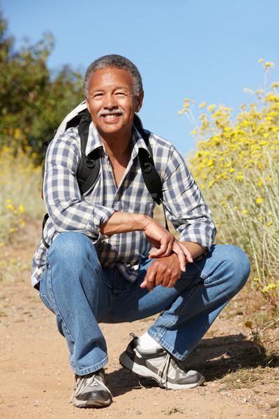 Senior homem país marcha feliz sol Foto stock © monkey_business