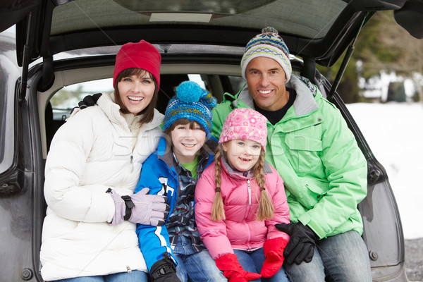 Family Sitting In Boot Of Car Wearing Winter Clothes Stock photo © monkey_business