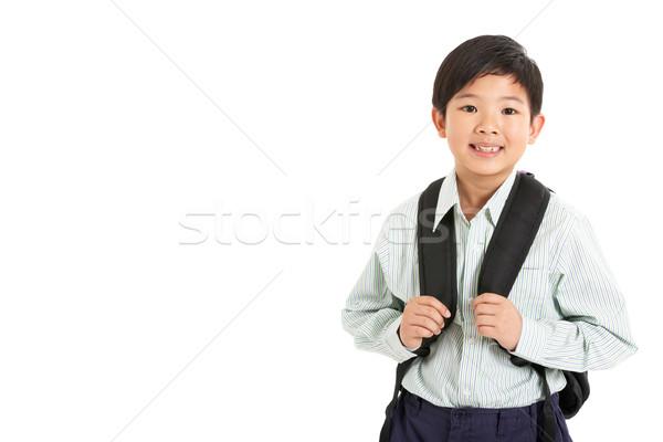 Stúdiófelvétel kínai fiú iskolai egyenruha gyerekek diák Stock fotó © monkey_business