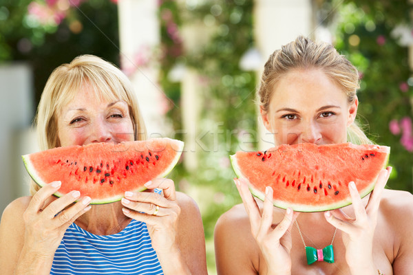 Mother And Adult Daughter Enjoying Slices Of Water Melon Stock photo © monkey_business