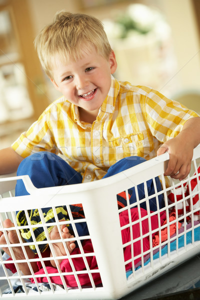 Boy Sitting In Basket Sorting Laundry On Kitchen Counter Stock photo © monkey_business