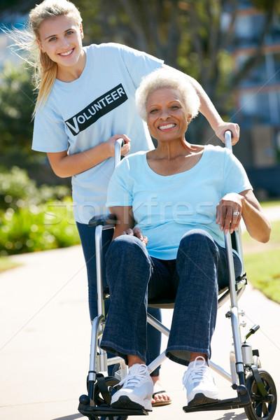 Teenage Volunteer Pushing Senior Woman In Wheelchair Stock photo © monkey_business