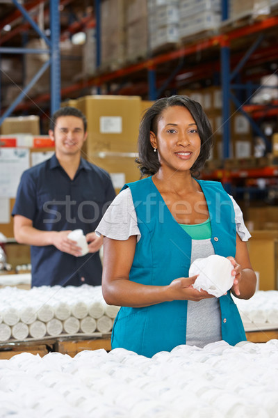 Factory Worker Checking Goods On Production Line Stock photo © monkey_business
