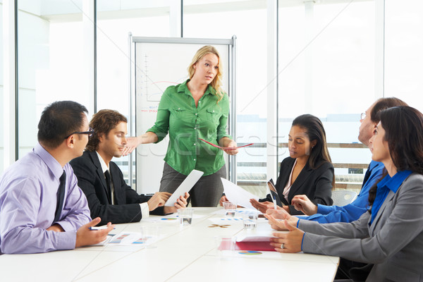 Businesswoman Conducting Meeting In Boardroom Stock photo © monkey_business