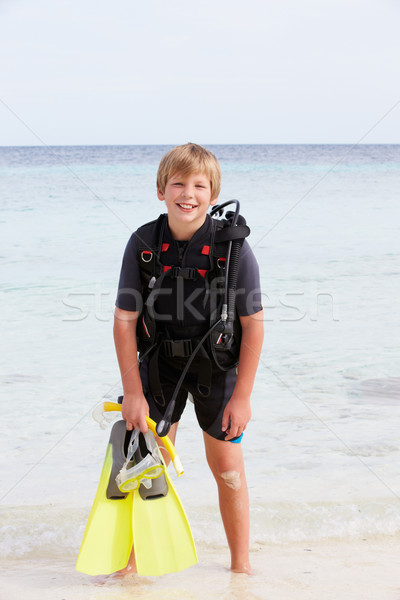 Boy With Scuba Diving Equipment Enjoying Beach Holiday Stock photo © monkey_business