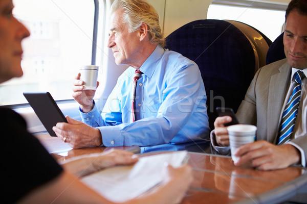 üzletember megnyugtató vonat csésze kávé nők Stock fotó © monkey_business