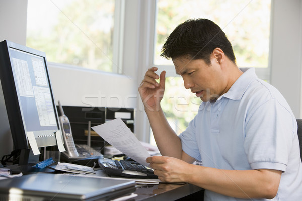 Man in home office with computer and paperwork frustrated Stock photo © monkey_business