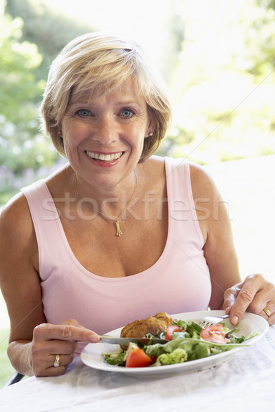 Middle Aged Woman Eating An Al Fresco Lunch Stock photo © monkey_business