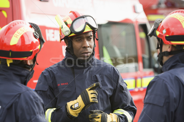 A firefighter giving instructions to his team Stock photo © monkey_business