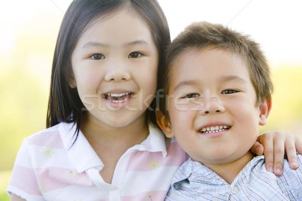 Bruder Schwester Freien lächelnd Mädchen glücklich Stock foto © monkey_business