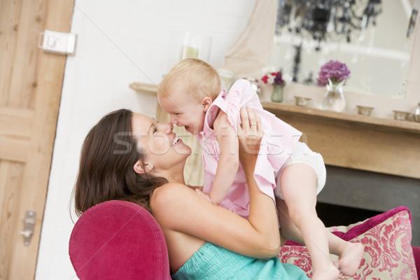 Incinta madre soggiorno figlia ridere Foto d'archivio © monkey_business
