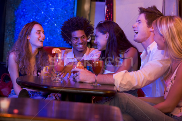 Group of young adults in a nightclub talking and laughing Stock photo © monkey_business