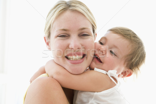 Mother and baby indoors hugging and smiling Stock photo © monkey_business