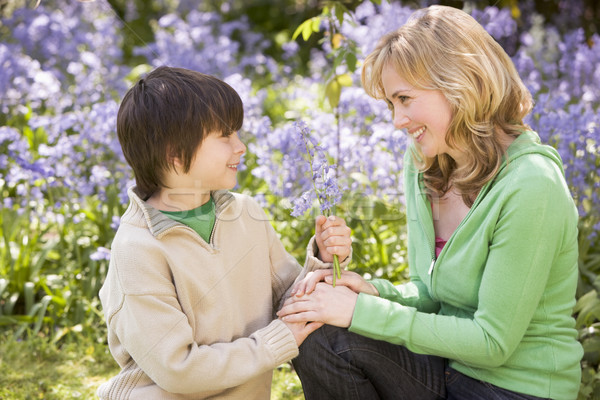 Stock photo: Mother and son outdoors holding flowers smiling
