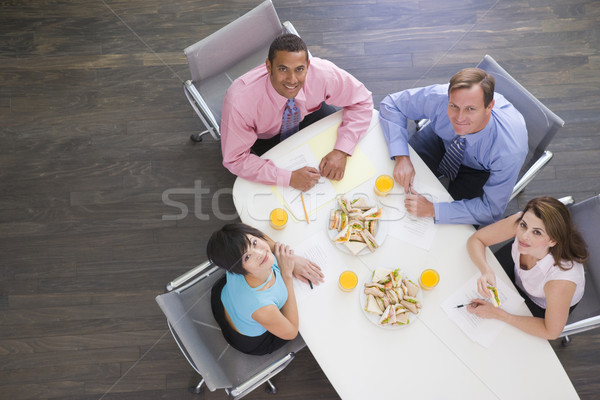 Vier boardroom tabel sandwiches glimlachend Stockfoto © monkey_business