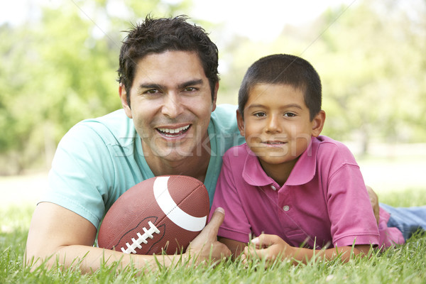 Father And Son In Park With American Football Stock photo © monkey_business
