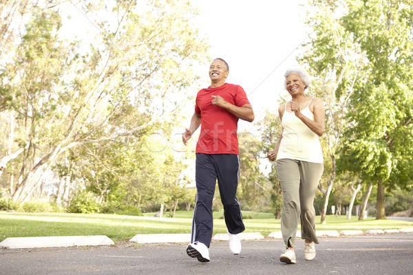 Senior Couple Jogging In Park Stock photo © monkey_business