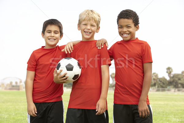 Stock photo: Young Boys In Football Team Celebrating
