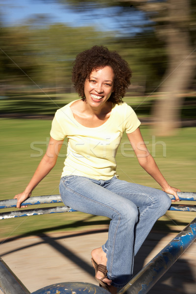 Young Woman Riding On Roundabout In Park Stock photo © monkey_business