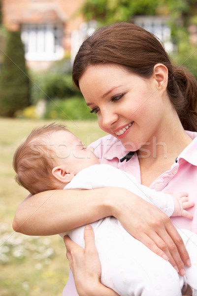 Close Up Of Mother Cuddling Newborn Baby Boy Outdoors At Home Stock photo © monkey_business