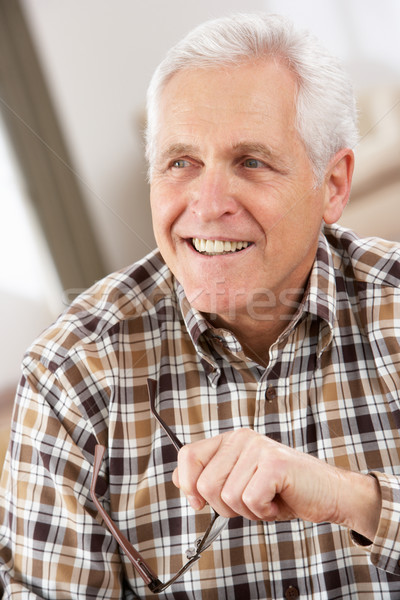 Senior Man With Glasses Relaxing In Chair At Home Stock photo © monkey_business
