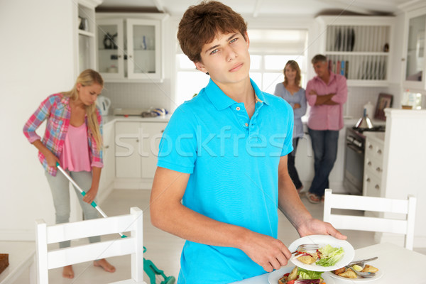 Teenagers reluctantly doing housework Stock photo © monkey_business