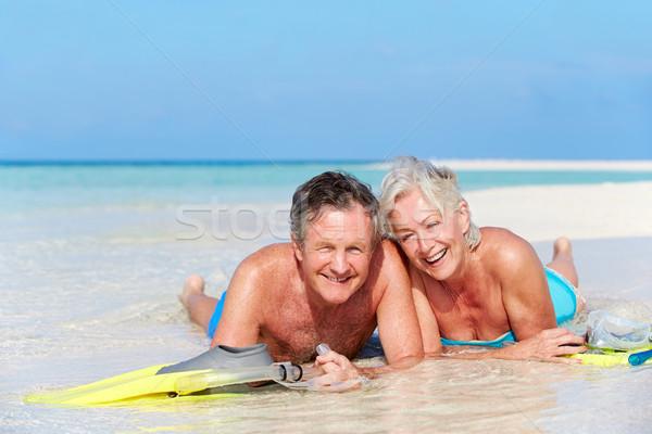 Senior Couple With Snorkels Enjoying Beach Holiday Stock photo © monkey_business