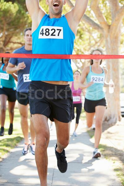 Férfi futó nyerő maraton nők boldog Stock fotó © monkey_business